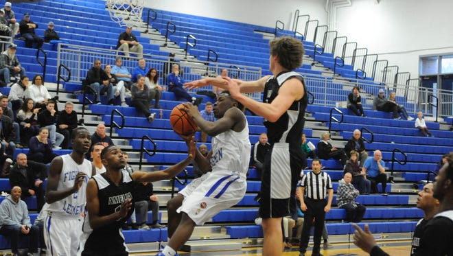 Lee High's Blaize Velvin goes up for a shot Thursday afternoon against Amelia County.