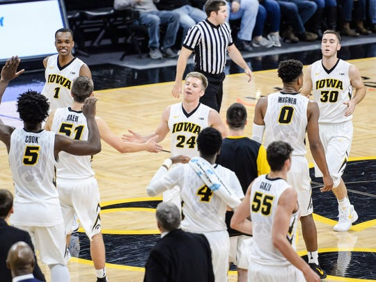 Iowa Hawkeyes guard Brady Ellingson (24) and teammates