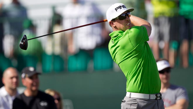 Hunter Mahan tees off on the 17th hole during the third round of the 2013 Waste Management Phoenix Open.