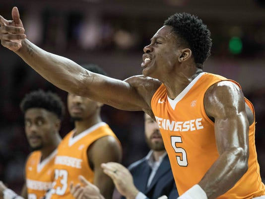 Tennessee forward Admiral Schofield (5) cheers on his teammates during the second half of an NCAA college basketball game against South Carolina, Saturday, Jan. 20, 2018, in Columbia, S.C. (AP Photo/Sean Rayford)