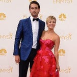 Ryan Sweeting, left, and Kaley Cuoco-Sweeting arrive at the 66th Primetime Emmy Awards at the Nokia Theatre L.A. Live on Monday, Aug. 25, 2014, in Los Angeles.