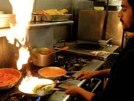 Chef Ranjit Singh works in the kitchen at The Masala Twist, which opened recently in the Channel Islands Harbor in Oxnard.
