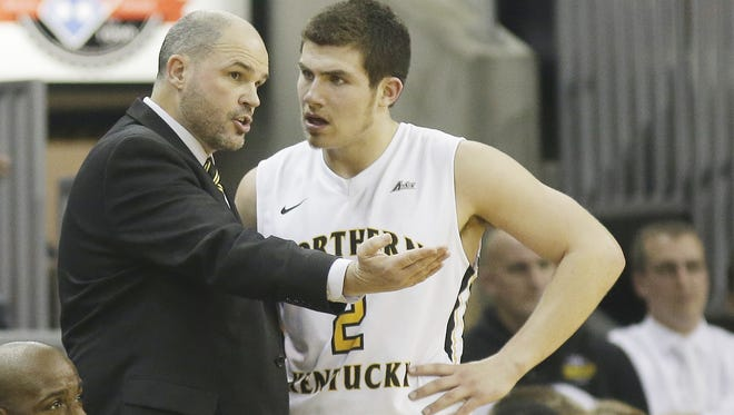 NKU coach Dave Bezold talks with Tayler Persons  on Dec. 7.