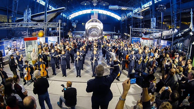 "The Air Force Band ""flash mob"" performs at the Smithsonian Air and Space Museum Udvar-Hazy Annex on Dec. 2, 2014."