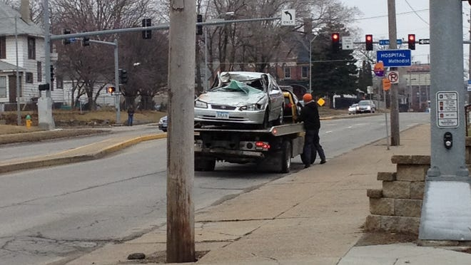 A car hit a school bus Friday morning after running a red light.