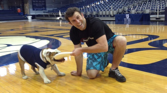 Trick-shot artist Brodie Smith tries to get his frisbee back from Butler University mascott Blue III.