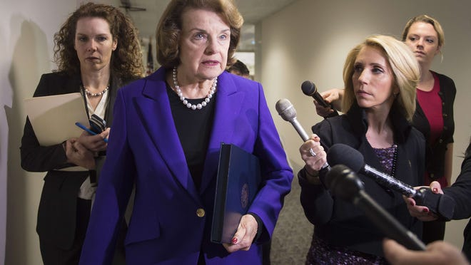 Senate Intelligence Chairwoman Dianne Feinstein, D-California, talks to reporters about the report on CIA interrogations of high-value terrorists a decade ago, while walking from her office on Capitol Hill in Washington, DC, December 9, 2014.