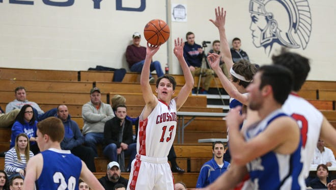 St. Henry's Ethan Berling puts up a shot for St. Henry Monday against Heritage in the Ninth Region All 'A' Classic at Lloyd.