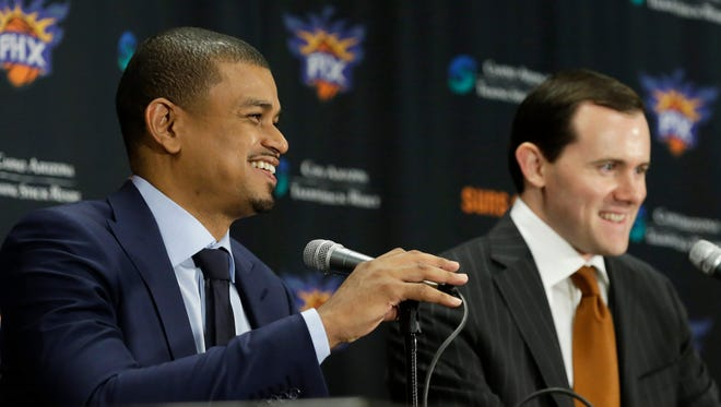 Phoenix Suns General Manager Ryan McDonough announces that Earl Watson is the Suns new head coach during a news conference at Talking Stick Resort Arena in Phoenix, Ariz., on Tuesday, April 19, 2016.