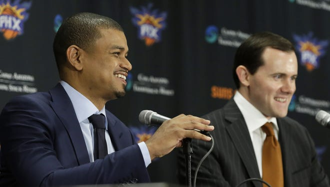 Phoenix Suns General Manager Ryan McDonough announces that Earl Watson is the Suns new head coach during a press conference at Talking Stick Resort Arena in Phoenix, Ariz., on Tuesday, April 19, 2016.