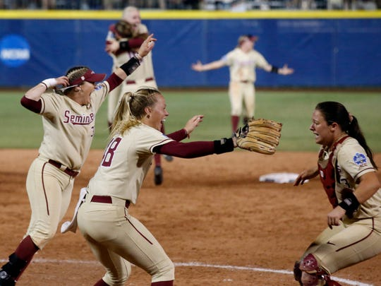 Florida State players celebrate after defeating Washington in the NCAA softball Women's College World Series in Oklahoma City on Tuesday, June 5, 2018. The Seminoles won their first softball national title. (AP Photo/Sue Ogrocki)