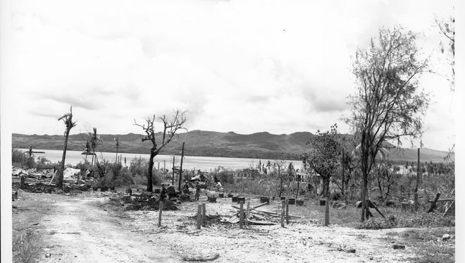 The remains of Apra Harbor and Sumay village, Orote Peninsula on Liberation Day, July 21, 1944.