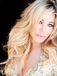 Taylor Dayne is in the midst of writing her autobiography.