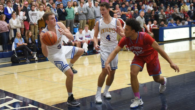 O'Gorman's Jaron Zwagerman (3) attempts to keep the ball in bounds Friday, Dec. 15, at O'Gorman.