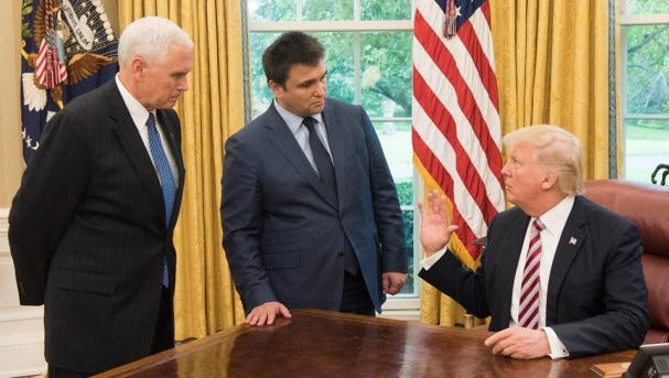 WASHINGTON, D.C. -- President Trump, right, talks to Ukraine's Foreign Minister Pavlo Klimkin as Vice President Pence listens at the Oval Office in the White House, May 10, 2017. Trump said the U.S. supports Ukraine, Klimkin told USA TODAY.