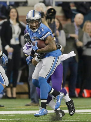Detroit Lions free safety Glover Quin is stopped by Minnesota Vikings running back Matt Asiata after a 56-yard interception return during the first half at Ford Field in Detroit on Sunday, Dec. 14, 2014.