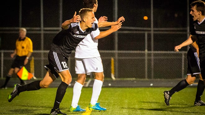 Ankeny Centennial's Nermin Kremic celebrates after scoring a goal at Johnston in 2014. Kremic is second-ranked Centennial's top scorer with 14 goals in 2015.