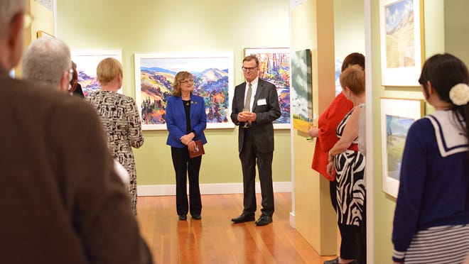 """Sandra Burnett and Edward """"Nick"""" Allis welcome guests to view the art collection that Allis donated to the Salem Art Association. """"The Debra and Edward L. Allis Collection"""" is on exhibit through June 27 at the Bush Barn Art Center."""