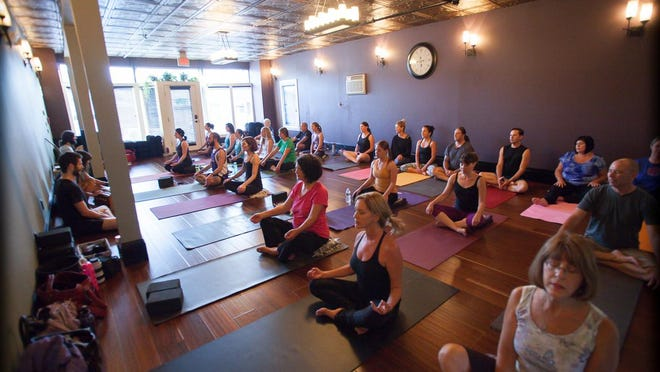 Students enjoy a yoga class in the bright, airy space at Kula Yoga & Wellness in Stanhope.