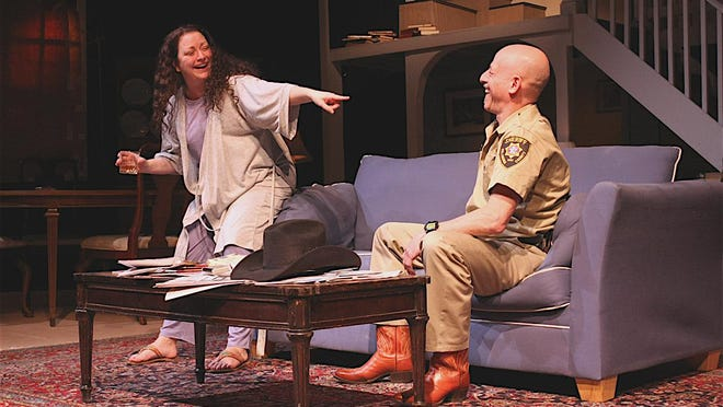 """MaryBeth Boylan (Barbara Fordham) and Jeffery Battersby (Sheriff Deon Gilbeau) are shown in a scene from the County Players production of Tracy Letts' """"August: Osage County,"""" running weekends through Feb. 20."""