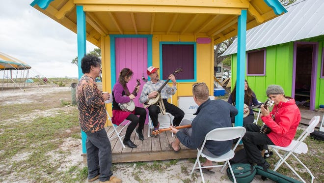 Richie Stearns (center, with banjo) teaches at Culture Camp at the Virginia Key GrassRoots Festival in Miami earlier this year. He'll be one of the instructors at the inaugural Finger Lakes GrassRoots Culture Camp from July 17-20 at the Trumansburg Fairgrounds.