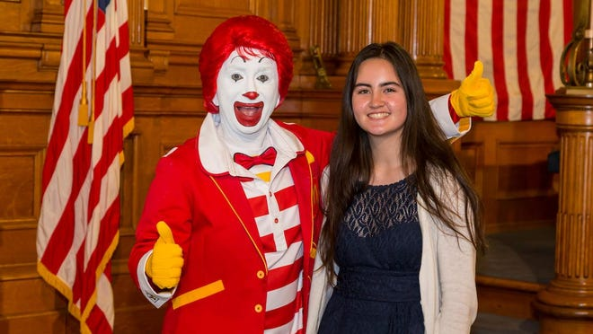 Recent Sheboygan North High School graduate Claudette Beane will receive a $2,000 scholarship and was recognized by Ronald McDonald during the Ronald McDonald House Charities Scholarship Ceremony.