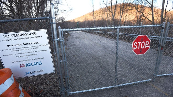 A gate blocking access to the Superfund site in Ringwood.
