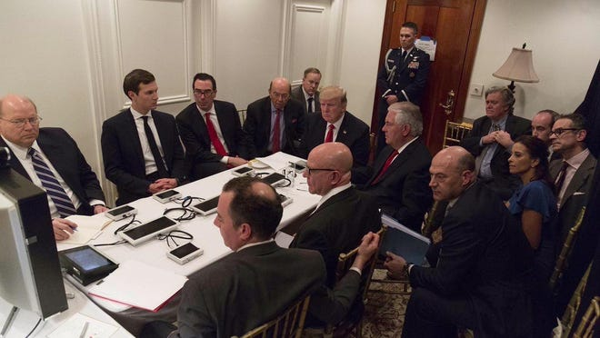 President Donald Trump is briefed on the Syria military strike in Palm Beach, Florida.