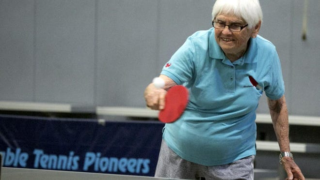 Billie Jones, former coach of the FSU volleyball and softball programs, plays table tennis at the Senior Games.