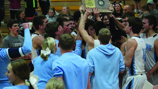 Skyline boys basketball team members celebrate the hard-fought championship trophy after defeating Syracuse in 2A Sub-State finals Saturday in Elkart.