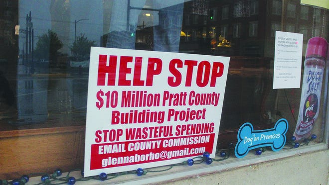 From storefront windows to resident yards, signs raising questions about Pratt County Commission approval of a multi-million dollar building project have popped up everywhere in and around Pratt. It may be several weeks before any official answers are given.