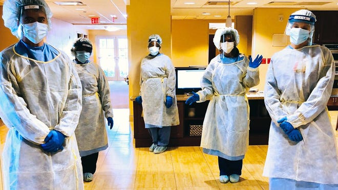 MorseLife Health System frontline staff don personal protective equipment, such as surgical masks, face shields, gloves and gowns, to help care for seniors during the coronavirus pandemic. The gear was provided by money raised through the foundation's COVID-19 Emergency Relief Fund.