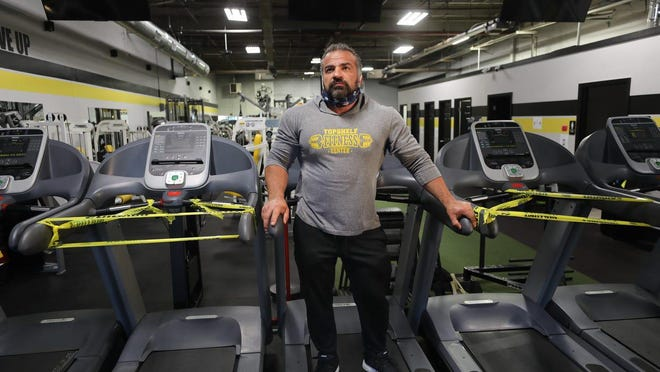 Tom Trilivas is the owner of Topshelf Fitness Center and a part of a small group of gym owners that have come together to create a health protocol for gyms to reopen. Here is Trilivis with one of the treadmills in between two  that are taped off. The treadmills are in his gym and used for social distancing.