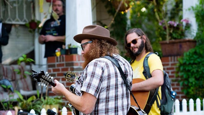 Musician Jordan Sutherland (at right, with Jones Smith) started the Porchella music series in his Wilmington neighborhood after the pandemic began, and it's been going strong for 17 weeks now.