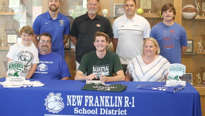 New Franklin graduated senior Gavin Bishop became the newest member of the Central Methodist men's basketball team after signing a national letter of intent Monday at the high school. On hand during the signing were (front row, left to right) Jonah Bishop, Wayne Bishop, Gavin Bishop and Michelle Bishop. (back row, left to right) New Franklin head coach Ross Dobson, CMU head coach Jeff Sherman, CMU assistant coach Matt Sherman and Tanner Bishop.