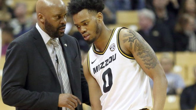 Missouri head men's basketball coach Cuonzo Martin talks with guard Torrence Watson (0) during a game against Tennessee on Jan. 7 at Mizzou Arena.