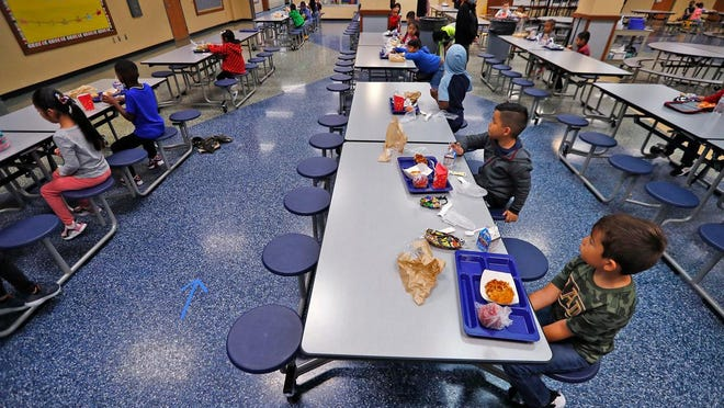 Students socially distance during lunch at Garden City Elementary School, Tuesday, Aug. 18, 2020.