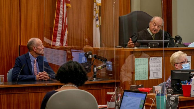 Richard Thornton, director of campaign finance at the state Board of Elections, appears as a witness for the state on Wednesday. Here, Superior Court Judge Daniel A. Procaccini asks Thornton a direct question during testimony.