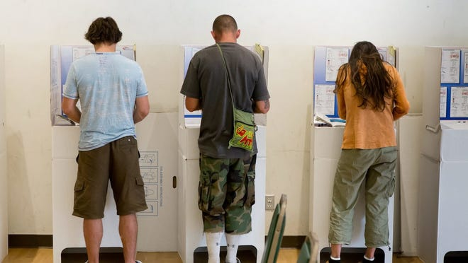 Young Californians vote at a polling place in Pacific Beach in June 2016.