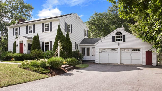 This Topsfield Colonial features graciously generous living areas within an easy and free-flowing layout.