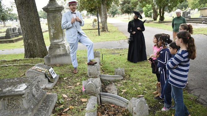 Linwood C. Hayne (left), portrayed by John Robertson, speaks to a Walk with the Spirits tour group at Magnolia Cemetery in 2015. The annual fundraiser for Historic Augusta returns Oct. 24-25 with spirits in two sections of Summerville Cemetery.