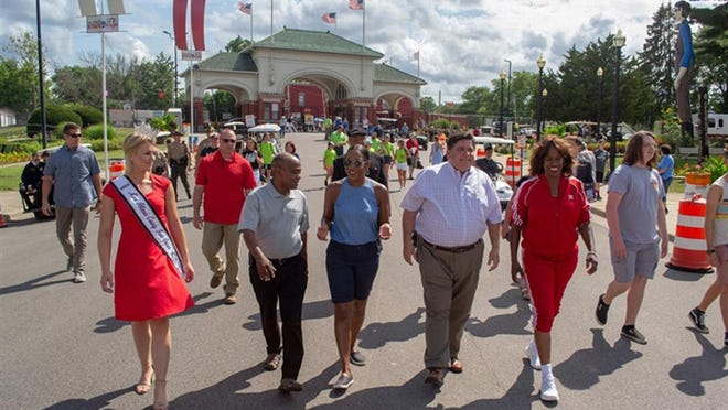 Gov. JB Pritzker joins 2019 State Fair Grand Marshal, East St. Louis native and Olympic champion Jacki Joyner-Kersee and others for the grand opening of the 2019 Illinois State Fair in Springfield. The state announced Friday that the governor would cancel this year's Fairs in Springfield and Du Quoin by executive order due to the COVID-19 pandemic.