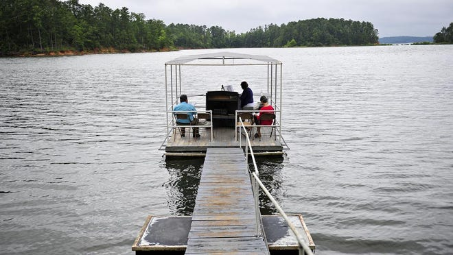 """Pam Bussey plays the organ during the St. John United Methodist Church's lakeside worship service, called """"Chapel Under the Pines,"""" on a Sunday morning. The services, which have been held since 1964, will run through Labor Day weekend."""