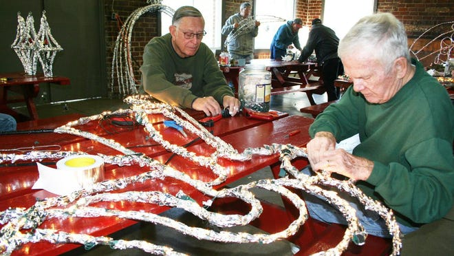 Jim Thurman and Alan Greenhagen, both of Kewanee, work on the light display at the Windmont shelter house in 2017. With the two co-founders of the longtime tradition dying recently, volunteers are trying to figure out how to carry it on.