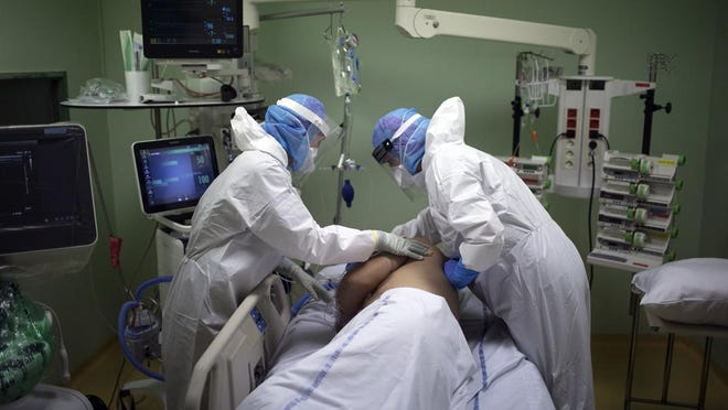 A COVID-19 patient being treated in intensive care.