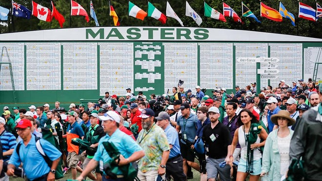 Patrons enter the course before the final round of the Masters Tournament at Augusta National Golf Club, Sunday, April 14, 2019, in Augusta, Georgia.