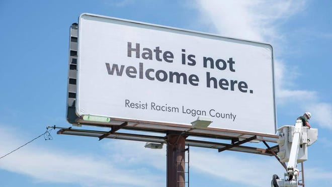 New billboard on Woodlawn Road tells travelers a point of view shared by the Resist Racism Logan County Facebook group.