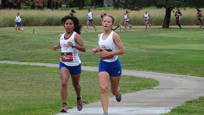 Norma Rodriguez and Serenity Larson competed at the Swather Invitational in Hesston on Sept. 10 for the Dodge City High School Lady Demons cross country. SUBMITTED PHOTO