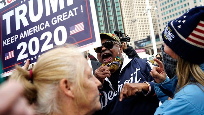 People argue their views during opposing protests at the TCF Center on Nov. 5, 2020, in Detroit. Arguments between opposing sides lasted for only a couple of minutes. The combined protests made up about close to a hundred people.