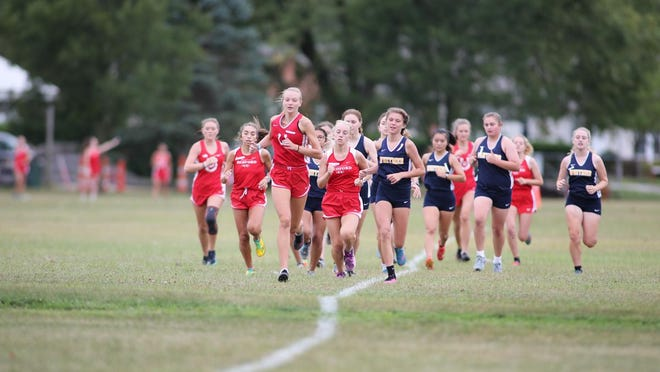 Bedford's Madison Foster and Alyssa Dorn lead the pack against Whitmer last season.